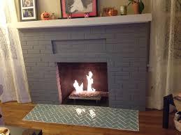 herringbone sage green glass tile fireplace hearth
