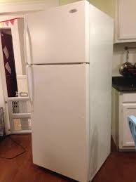 Here it is, my perfectly adequate, functioning perfectly, perfectly boring  refrigerator: