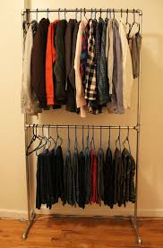 DIY Pipe Clothing Rack-family closet clothing rack - how to. Maybe have  black pipes and paint corners gold?