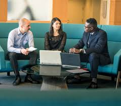 four people at conference table