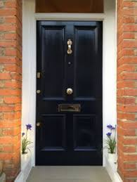 a victorian four panel front door in farrow ball railings paint