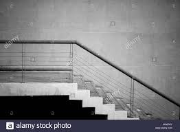 interior contemporary black modern office. Black And White Stone Concrete Staircase. Modern Architecture Detail. Refined Fragment Of Contemporary Office Interior / Public Building Stock Photo: H