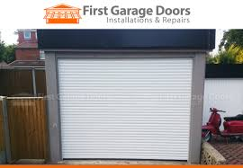 new remote controlled roller garage door with new timber surround