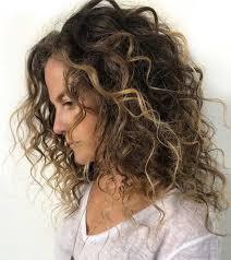 medium length balayage curly hair
