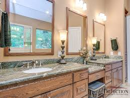 bathroom after remodeling by incorporation of rainforest green marble countertops