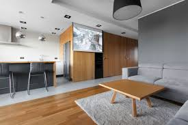 Open apartment by modelina living room seating area