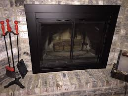 black fireplace glass doors