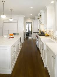 Example Of A Classic Dark Wood Floor Eat In Kitchen Design In New York With