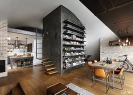 ... Concrete wall panels with shelves and wooden stairs ...