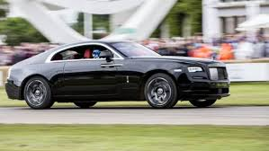 rolls royce wraith white and black. a rollsroyce wraith black badge on run at the 2016 goodwood festival of rolls royce white and
