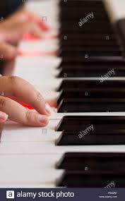 Piano Key Lights Hand On A Piano Keyboard With Red Lights In The Keys Stock