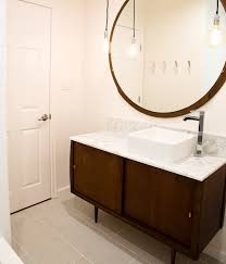 stylish modular wooden bathroom vanity. Wonderful Vanity Superb Round Mirror On Plain Wall For Modern Bathroom Vanity With Single  Sink Wood Washbasin Stand Clean Floor Side White Door Inside Stylish Modular Wooden