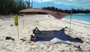 9 foot Kelty Noah\u0027s tarp used as a beach shelter sun shade on Jolly Hall The Tarp Beach Shelter Sun Shade - Travel-Snobs.com