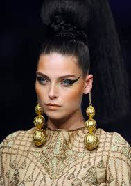 Ancient Egyptian Hair Style slicked up hair with braids & buns in zareena springsummer 2015 2017 6505 by wearticles.com