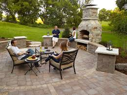 outdoor fireplace paver patio with seat wall and fireplacetransitional patio minneapolis