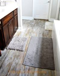 how to pull up carpet and paint a suloor to look like aged wood you