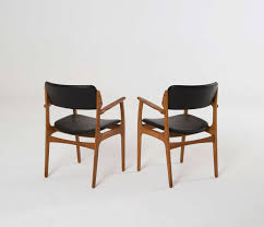 large set of 11 danish armchairs in teak and original black upholstery in excellent condition for