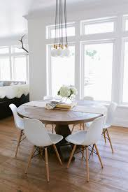 dining room white and dark wood chairs table with brown cushion cream fur rug knitted