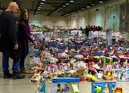 chino based isaiah s rock volunteers gather at fairplex emble food toy packages for those in need