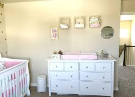 We opted to put the changing pad on top of a dresser, instead of having a  designated changing table. The dresser is this one from IKEA.