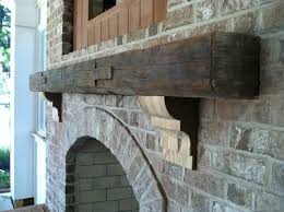 stone fireplace with reclaimed wood mantel and corbels reclaimed wood fireplace mantel uk