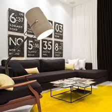 zingy yellow rug adds colour to an industrial styled living room