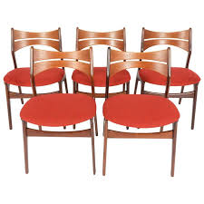 set of five erik buck model 310 dining chairs in teak