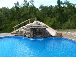 Image Diving Custom Waterfall And Slide All Rock Was Hand Laid By Our Crew Pool Pro Pool Pro Custom Pools