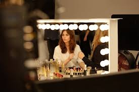 makeup touch ups with felicity jones on set for the spring summer 2018 radiant day caign shoot photo courtesy of clé de peau beauté