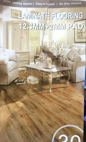 laminate flooring with pad. Laminate Floor With Pad Colonial Walnut Flooring Attached Boxes Feet Furniture In .