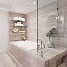 Contemporary beige floor drop-in bathtub idea in Miami with beige walls