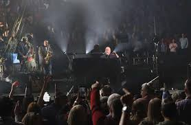 greg allenthe piano man celebrates 70fans some decked out in party hats enjoy billy joel s madison square garden performance on may 9 2019