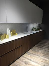 backsplash lighting. marble kitchen backsplash and countertop decorated with gold accessories eye cathing led under cabinet lighting