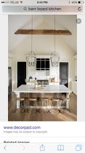 Barnwood cabin kitchen transitional with white countertop two pendant lights