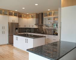 white kitchen. Elegant Contemporary Kitchen Cabinets With Exotic Dark Granite Countertops White For