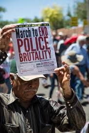 the people take to the streets to protest police brutality a  a er holds the flyer on saturday 21 to end police