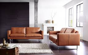 modern leather sofa. Brown Modern Leather Sofa With White Furry Rug And Fireplace Also Dark Wooden Flooring For Living Room Design Ideas I