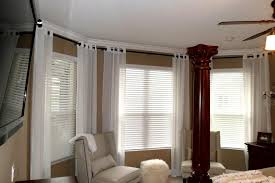 image of hanging curtain rods bay window