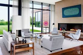 a richard pousettedart painting surveys the living room next to fireplace is modern interior house design27 interior