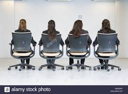office furniture for women. Rear View Of Business Women Sitting On Office Chairs Furniture For O
