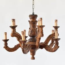 vintage wood chandelier from france with primitive carved arms