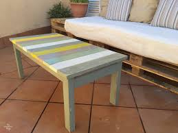 if you love color in your diy patio furniture then this colorful wood slat table