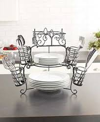 it features a construction with the bottom for dinner plates the middle for salad or desse find this pin and more on dining room furniture