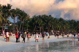 tourists frolic during sunset in boracay philippines october 26 2018 reuters ronn bautista reuters