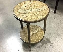 granite end table hotel surplus pebble beach round outdoor and chairs