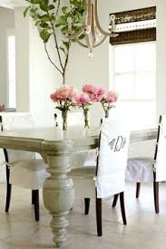 love the chair slipcovers feminine black and white dining room