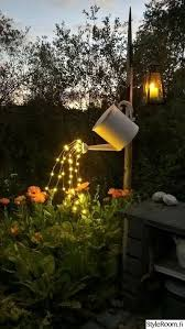 Your garden flowers can enjoy lighting drops from this repurposed watering  can. LOVE these gorgeous and simple ideas!