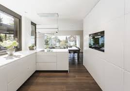 White kitchen Granite The Allwhite Kitchen Has An Lshaped Work Area And Several Cupboards House Garden These 30 White Kitchens Are Anything But Ordinary Dwell