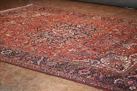 676 heriz rugs this traditional rug is approximately 9 6 x12 1