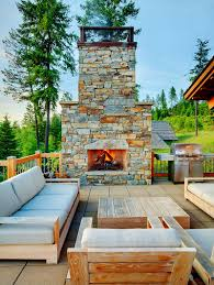 open deck design with plush furniture and cool stone fireplace design mckinney group